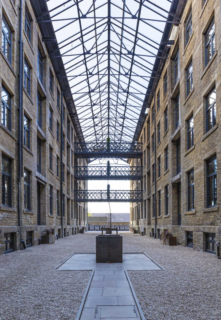 The full-height glass atrium at the heart of Conditioning House